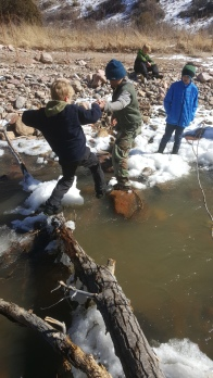 Helping the younger guys across a tricky creek crossing!