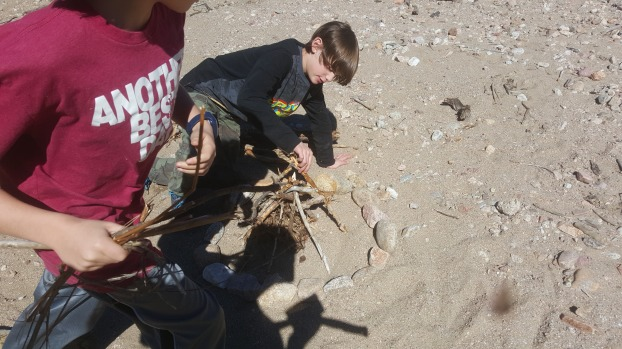 Logan puts the finishing touches on his structure while Jax brings his materials home